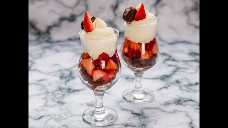 A Valentines Day dessert can very easily be this wonderful parfait! Let the strawberries and raspberries soak in a mixture of sugar and Bourbon for half an hour. Meanwhile prepare a smooth filling made of cream cheese and powdered sugar and cube a store-bought chocolate loaf. Assemble the parfait in a glass by layering together the fruits and chocolate loaf cubes. Top with whipped cream!  --------------------- Follow us on: Facebook: http://sodl.co/2dRsH0l Instagram: http://sodl.co/2eMvdCP…