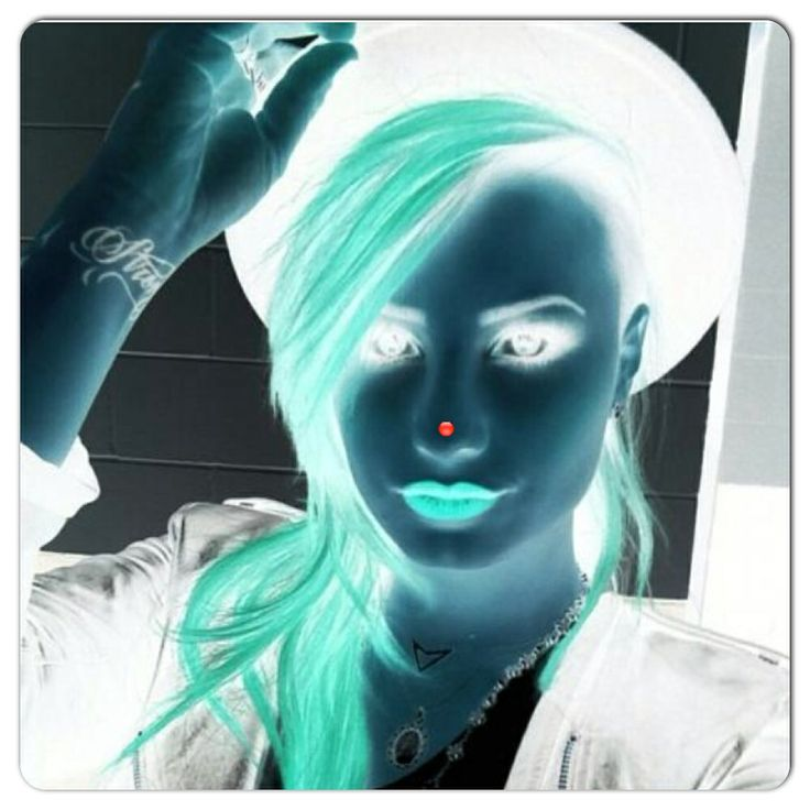 Stare at the red dot on Demi's nose for 30 seconds then blink really fast while looking at the wall