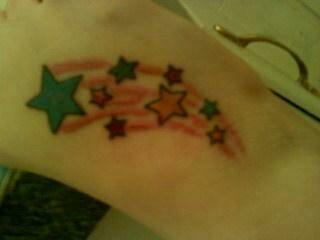 Shooting star tattoo on my foot