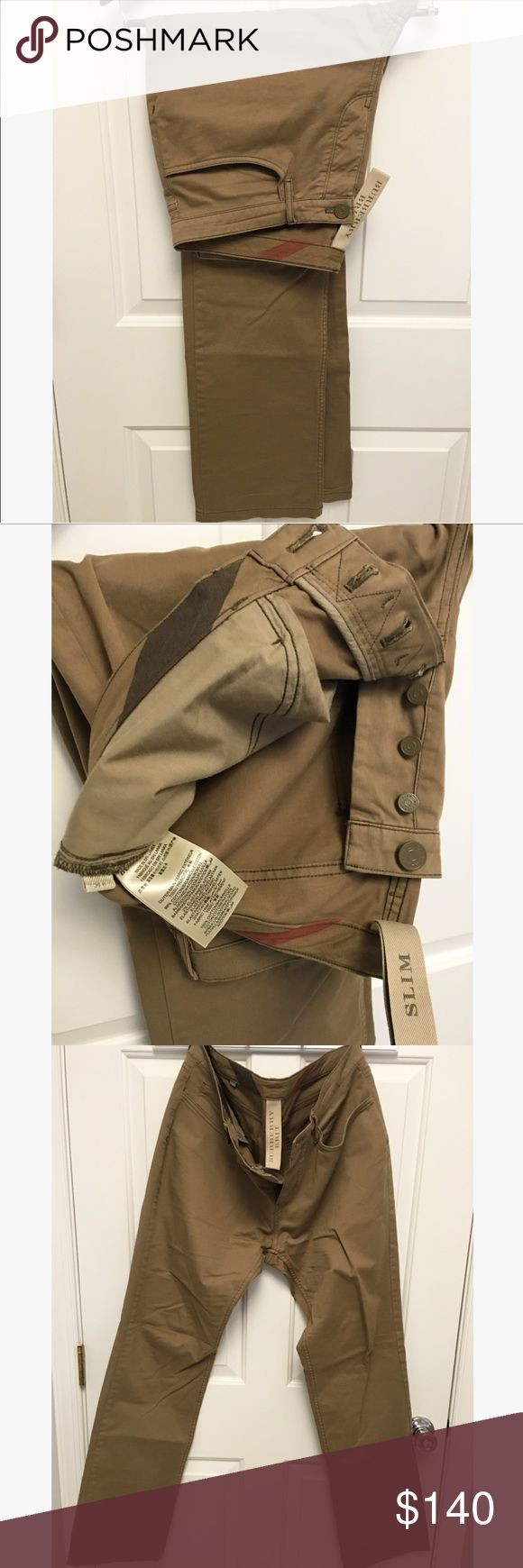 Burberry Slim Fit Chino-khaki Like new and only worn once. Mint condition. Slim fit Burberry cotton twill chino in khaki brown color. Fits true to size and sold just by waist size. Belt loops banded waist zip fly button closure. Two back pockets with Burberry emblem on one. Burberry Pants Chinos & Khakis