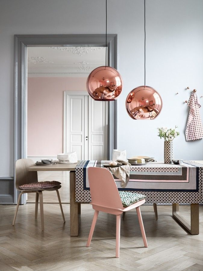 Pink's not just for the nursery. The soft pastel shade plays up the feminine accents in this #moderndesign. Featuring Tom Dixon's copper pendant