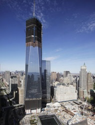 """FILE - In this April 17, 2012 file photo, One World Trade Center, rises above the lower New York City skyline as the National September 11 Memorial can be seen at lower right. More than a decade after 9/11, no one's quite sure what to call the spot that was once a smoldering graveyard but is now the site of the fast-rising, 1,776-foot skyscraper that will replace the twin towers. Some are calling the new skyscraper """"One World Trade Center,"""" but it's still """"ground zero"""" to others. (AP Photo)"""