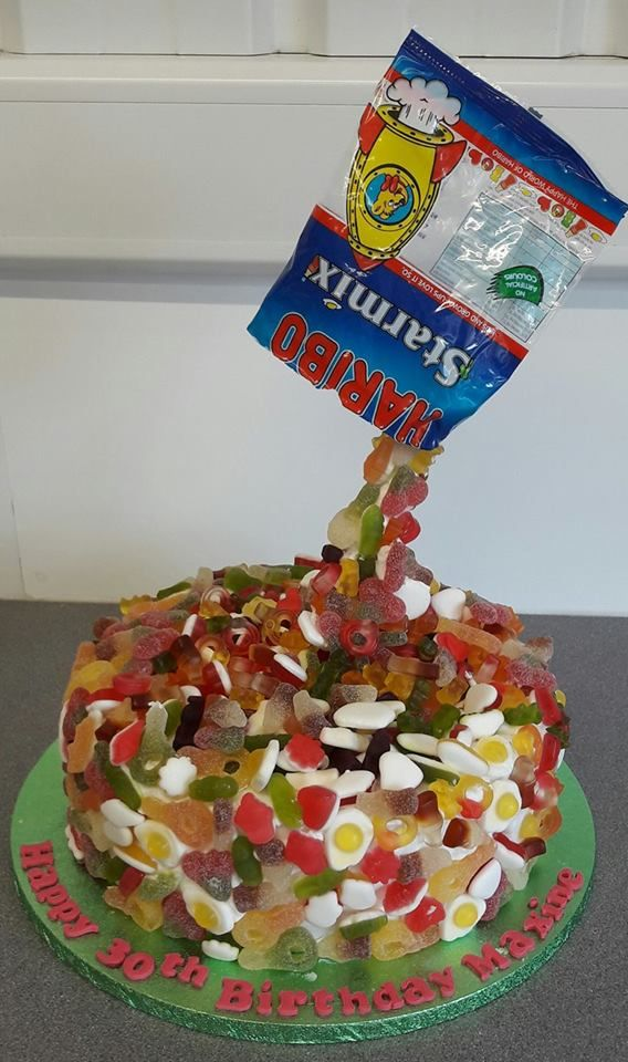 A 30th birthday cake for a Haribo sweet loving client.<br /> Vanillasponge with jam &buttercream filling smothered in Haribo sweets.<br /> From £85<br />