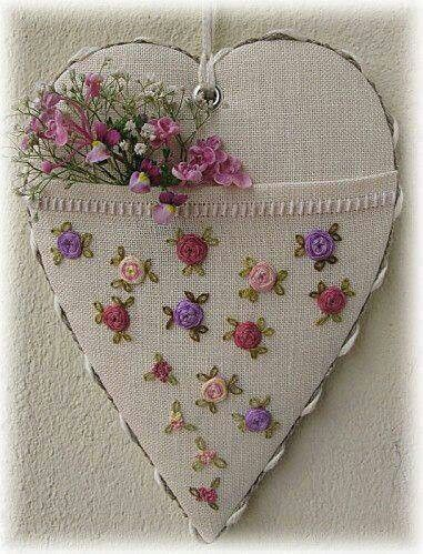 Beautiful embroidered roses on a linen heart sachet
