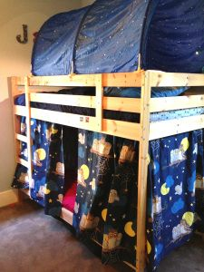 Turn a bunk bed into a fort. Mount curtains, tent top, lanterns.