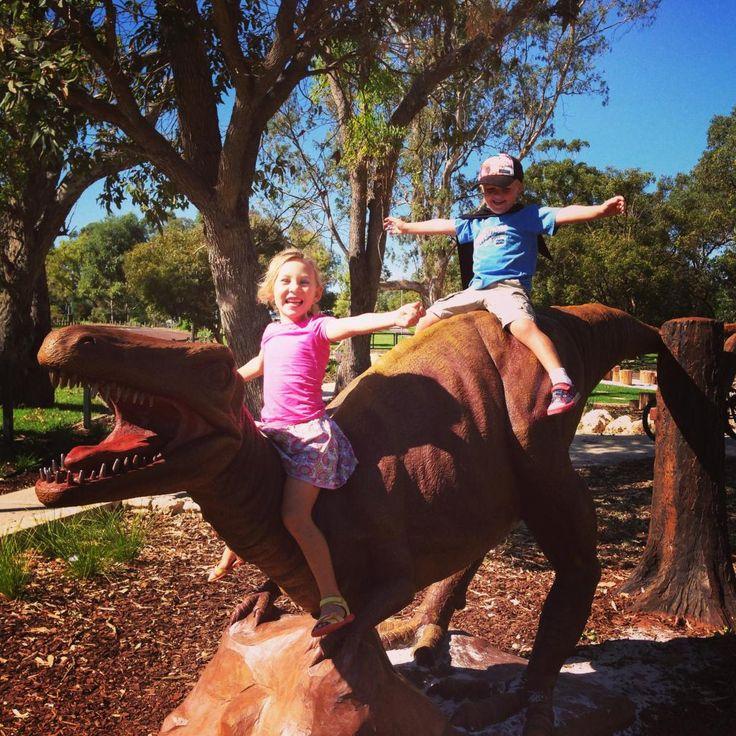 Kingsway Regional Playground A climbable dinosaur plus dinosaur bones buried in the sandpit.