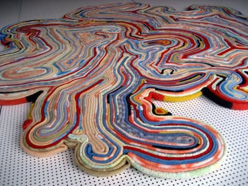 This recycled blanket rug by Tejo Remy and Rene VeenHuizen uses strips of old blankets in a new way. Turned on edge, the blanket strips give the rug cush and a luxurious thickness that's awesome underfoot...