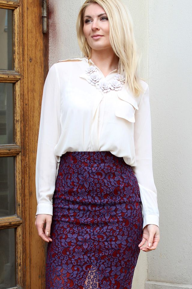 Anna-Maria wearing white blouse and purple-red lace pencil skirt.