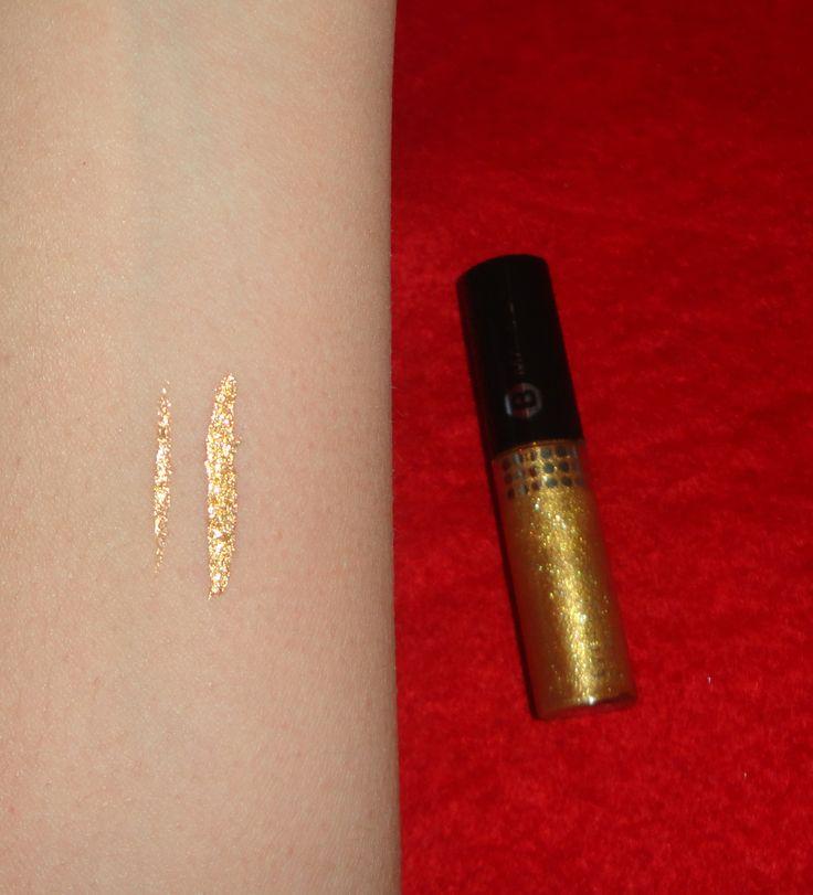 Glitter gold eyeliner I really love it! click here -> http://www.prettybeautyblog.com/2013/12/19/329/