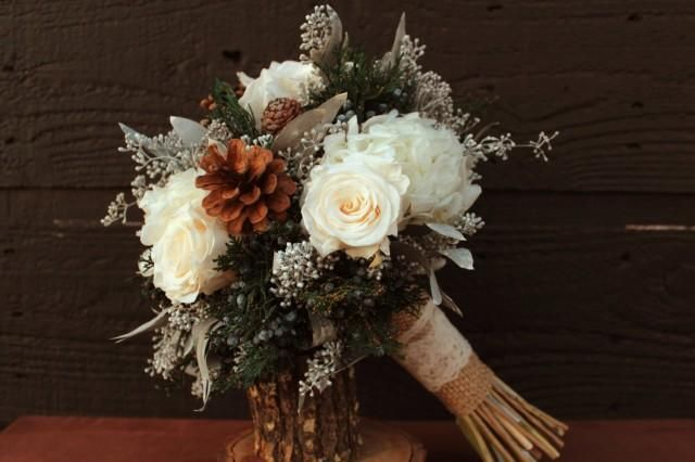 Weddbook is a content discovery engine mostly specialized on wedding concept. You can collect images, videos or articles you discovered organize them, add your own ideas to your collections and share with other people | Rustic Winter White Wedding Bouquet, Winter Wedding Bouquet, Winter Brides Bouquet, Woodland Pinecone, Rose and Hydrangea Wedding Bridal Bouquet This listing is for a gorgeous rustic winter wedding brides bouquet. The bouquet is made from preserved fragrant blue berried…