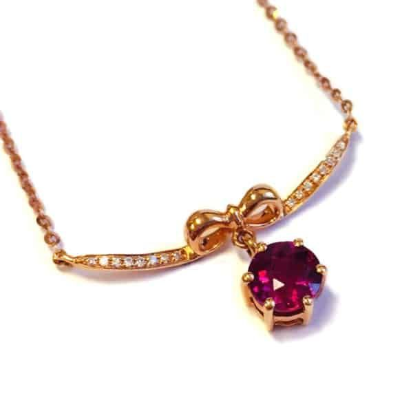 Argo & Lehne Jewelers. Rose gold tourmaline diamond necklace.  This gorgeous tourmaline is sweetly packaged with diamonds and a sweet bow.