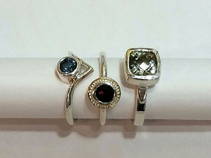 A bevy of rings! London blue topaz in sterling silver, garnet in sterling silver with gold bezel, and prasiolite (green amethyst) in sterling silver.