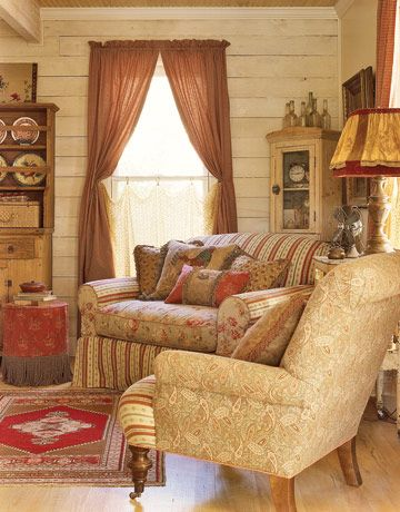 neutral and red toned chairs in a sitting area near window with curtains