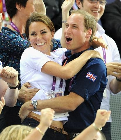 A rare public display of affection from Wills and Kate at London 2012!