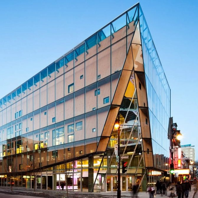 This mixed-use building in Montreal sorta reminds us of Swiss cheese