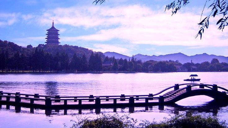 A stunning take of the beautiful serene West Lake #hangzhou #china #asia #travel #explore  #traveler #westlake #pagoda