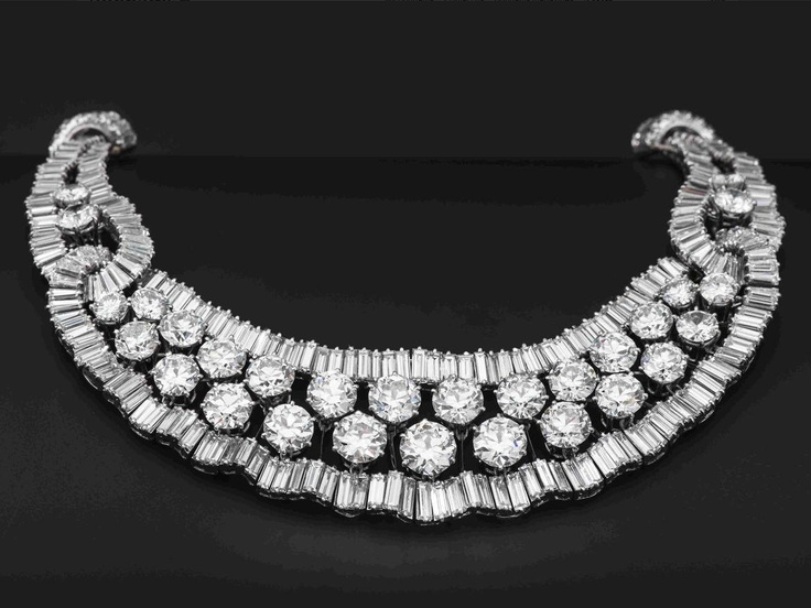 A diamond necklace, circa 1965 The highly articulated openwork frame set with brilliant-cut diamonds between undulating rows of baguette-cut diamonds, diamonds approximately 57.20 carats total, largest brilliant-cut diamond weighing 2.49 carats, later backchain