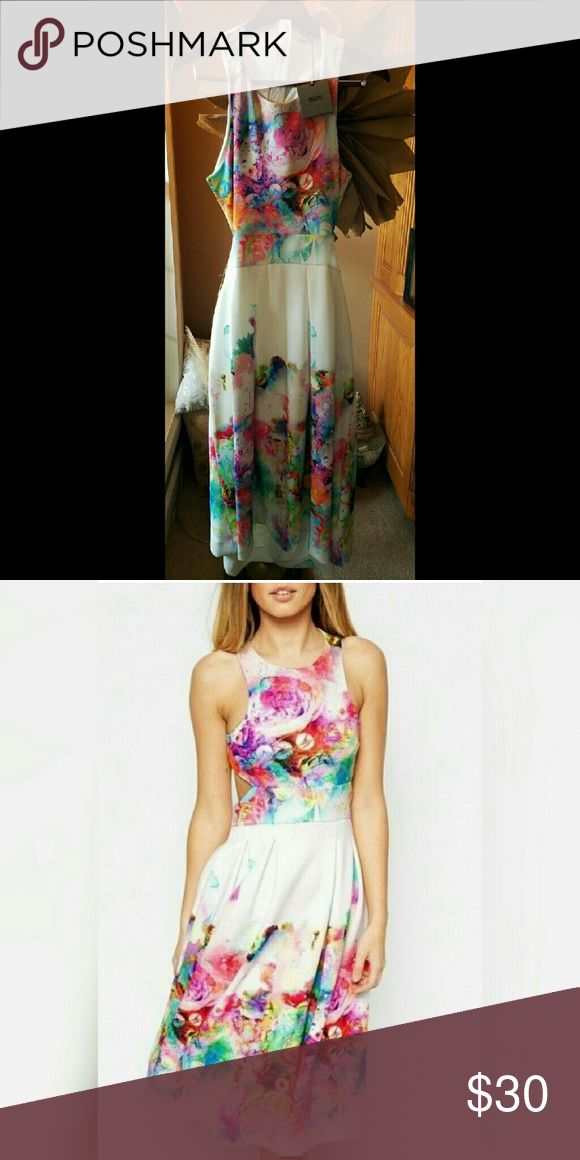 ASOS cut out dress Perfect for spring and summer. Never worn. Watercolor/Floral print design with cut out back. NWT ASOS Dresses