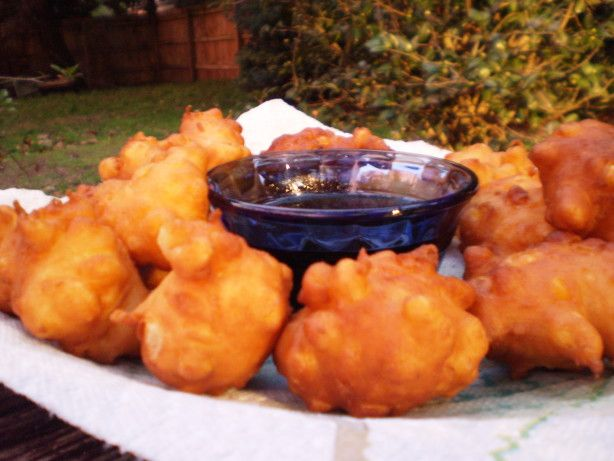 Corn Fritters are a pleasing side dish. The sugar can be adjusted if you like things a bit sweeter. The recipe calls for deep frying them, but I have also done them in a skillet with just enough oil to cover the bottom of the pan.