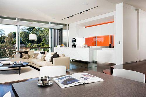 Woollahra kitchen.  Flash of orange in a white minimalist look.