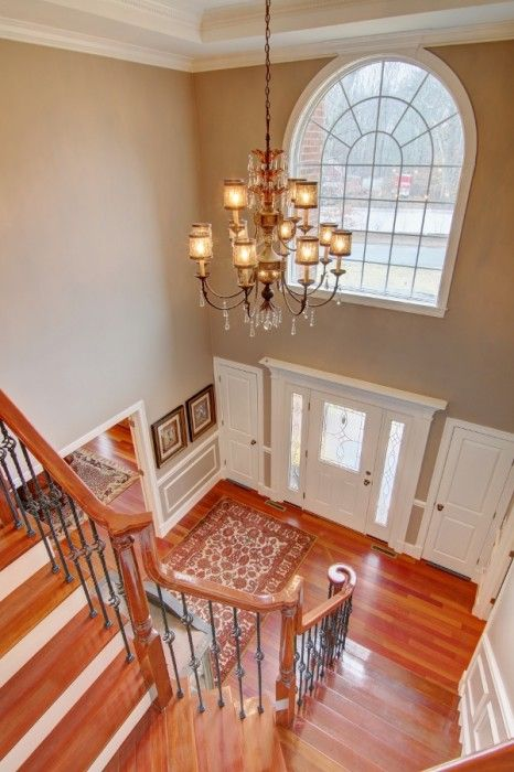 Crown Molding Two Story Foyer : A two story foyer showcasing grand staircase with