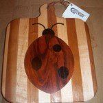 Cheese Board with Inlaid Ladybug by Kentucky Cutting Boards. $49.50. Handle has a leather strap for hanging. American Cherry Cheese Board. www.kentuckycuttingboards.com. Inlay of African Padauk OR Brazillian Cherry. Dots of African Wenge. Kentucky Cutting Boards are Made in the USA.  All of our cutting boards are made from sustainable yield hardwoods and support our region's hardwood industry. The side or back of every board is stamped with our signature horseshoe brand to i...