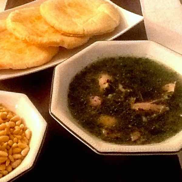 Mlokhia is a traditional Egyptian soup made with Jew's mallow leaves and chicken, and typically served with shami bread.