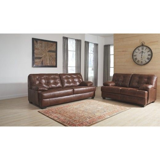 Inspired by a great pair of men's oxford shoes, this loveseat is quite handsome. Entire seating area with plush pillow top arms is covered in 100% leather. Tufting and two-tone color effect add interest to the buttery soft texture. Signature Design by Ashley is a registered trademark of Ashley Furniture Industries, Inc.