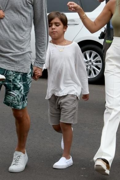 Mason Disick wearing Vans Classic Slip-on Sneakers and Daniel Patrick Kids Roaming Jogger Short in Wheat