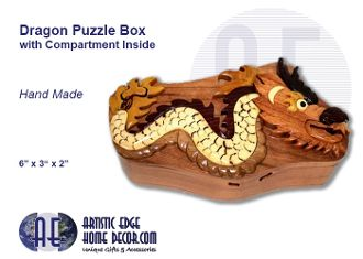 """Dragon Puzzle Box  Unique Wooden Design Puzzle Box with hidden compartment in middle of box  Beautify hand carved/made Wooden Puzzle Box. Each piece in uniquely created and is hand made. Opens up into several pieces to reveal a hidden compartment inside.  Size: 6"""" x 3"""" x 2""""  Very high quality."""