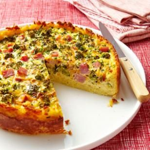 This quiche recipe is full of broccoli, Cheddar cheese and smoky ham surrounded by a crispy hash brown crust. Look for precooked shredded potatoes in the dairy section or in the produce section—or use frozen hash brown potatoes in this easy quiche recipe.