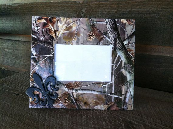 Hey, I found this really awesome Etsy listing at http://www.etsy.com/listing/166418959/camo-picture-frame