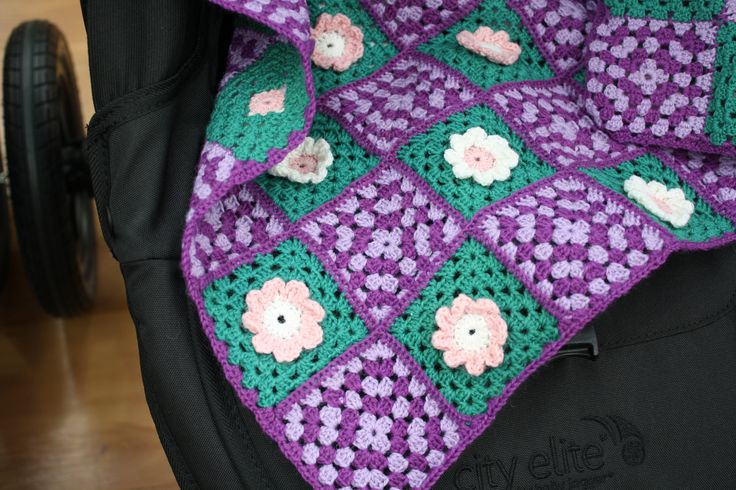 Wrap them in flowers. This crocheted cot blanket was designed by my 9 year old daughter.