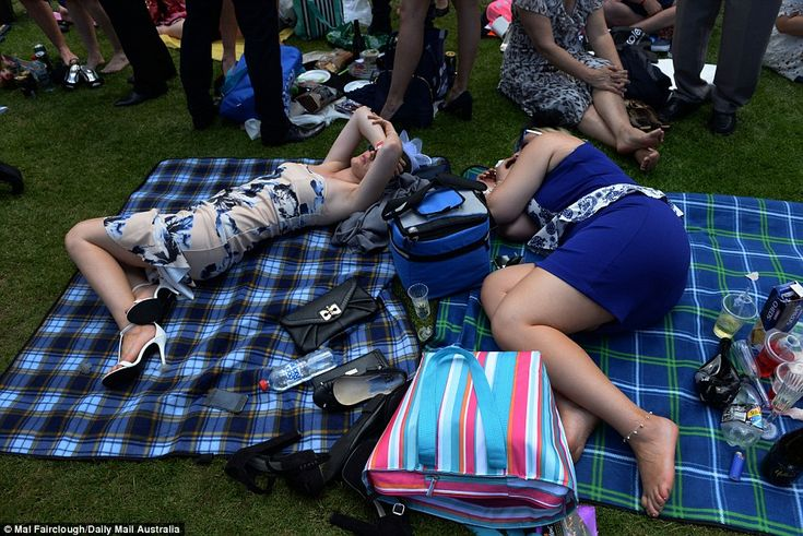 Obviously these two have had a big day, opting to relax on the picnic rug...