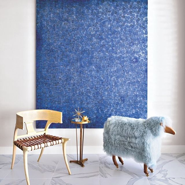 A John Millei oil and a vintage sheep from @dragonetteltd define a living room seating area in Patrick Dragonette and Charles Tucker's Palm Desert home #LuxeCA Mar/April Interiors: @dragonetteltd Photo: @karynmillet @sandow • • • #instaluxe #luxuryinteriors #calidesign #palmdesert #artanddesign