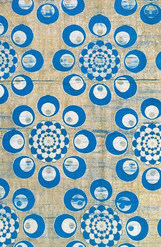 Textile fragment. The main blue + white motif makes me think of moon gates...