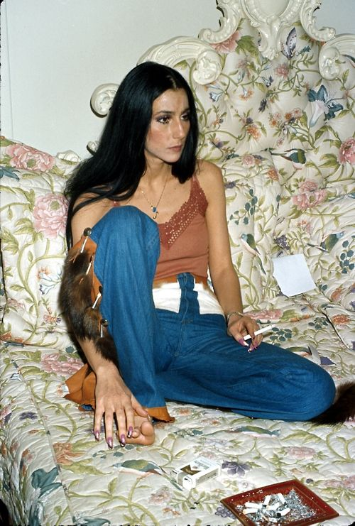 Cher  --- Please note the square amber ashtray.  Back in the 1960s 1970s into the 1980s It was more common to visit someone where there was a smoked pack of cig butts in an ashtray than not. Very  common.