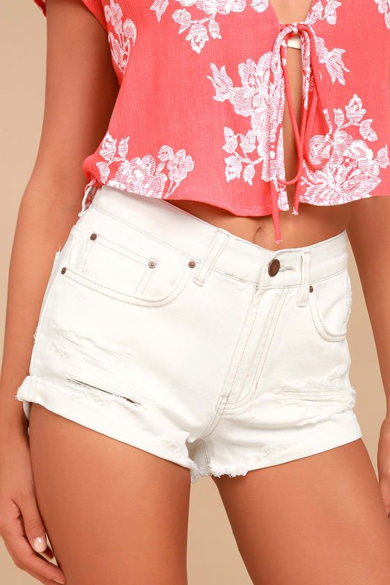 The Billabong Just Me White Distressed Denim Shorts are perfect for pairing with a bikini! White denim forms these mid-rise shorts with a five-pocket cut, belt loops, plus a branded top button and hidden zip fly. Distressing and rolled, frayed hems completes the laid-back look!