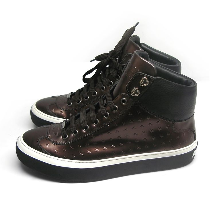 High-top Jimmy Choo Argyle Storm sneakers in metallic brown calf featuring the designer's iconic stars. Round toe. Tonal lacing. Embossed logo at padded tongue. Padded collar. Leather lining in black. Silver-tone hardware. Tonal rubber sole and stitching. Size: 41.Made in Italy.