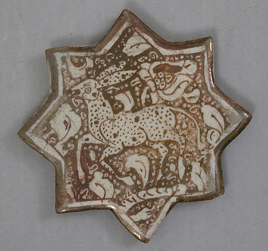 Star-Shaped Tile  Object Name:Star-shaped tile  Date:13th century  Geography:Iran  Culture:Islamic  Medium:Stonepaste; luster-painted  Classification:Ceramics-Tiles  Credit Line:Gift of Rafael Guastavino, 1928  Accession Number:28.89.5