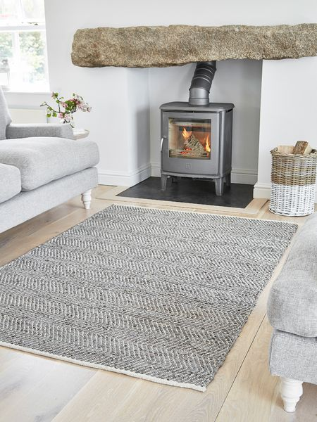 Dress up any floor with our beautiful handwoven grey chevron rug.
