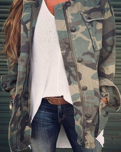 Camo jacket with white top and jeans.