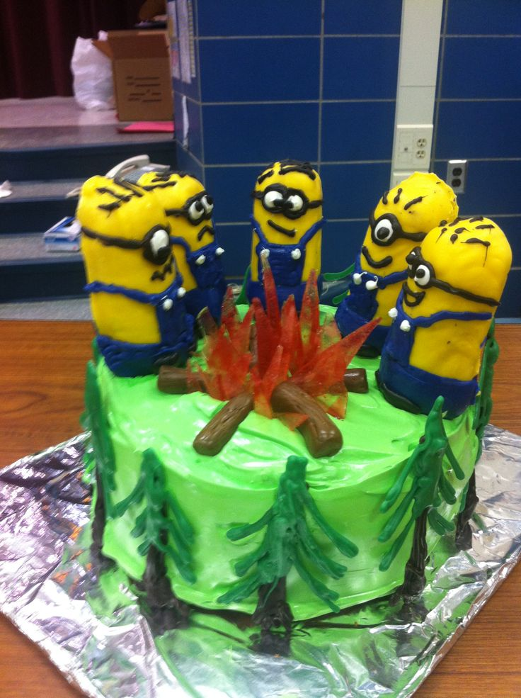 Camp Minion! S'more cake from Smitten Kitchen with chocolate trees, Tootsie Roll and Jolly Rancher fire, Twinkie minions.