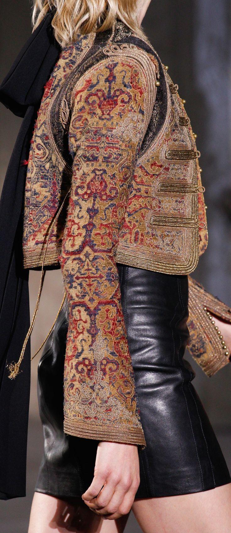 Saint Laurent S-17 RTW: tapestry military jacket, leather skirt.