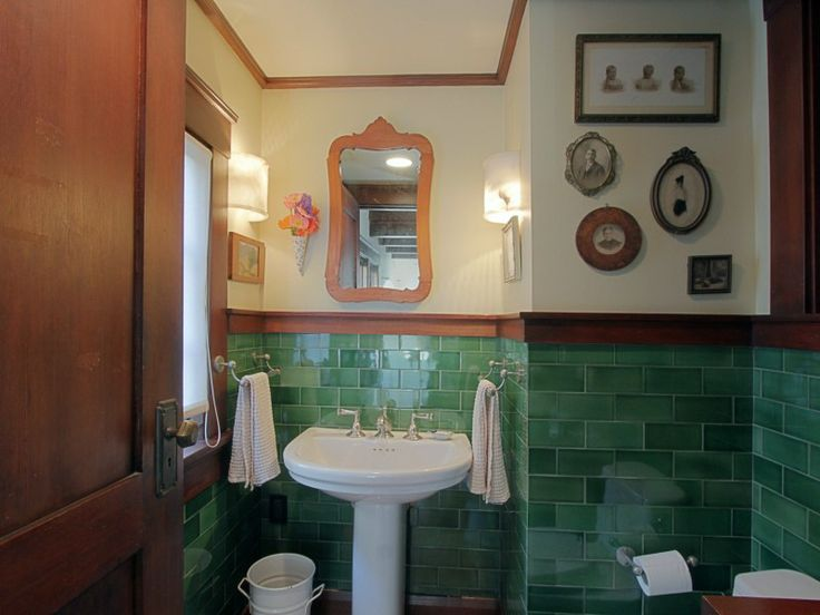 Bathroom with green subway tile and dark wood trim – The
