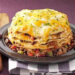Slow Cooker Enchiladas Recipe -As a busy wife and mother of two young sons, I rely on this handy recipe. I layer enchilada ingredients in the slow cooker, turn it on and forget about it. With a bit of spice, these hearty enchiladas are especially nice during the colder months. —Mary Luebbert, Benton, Kansas