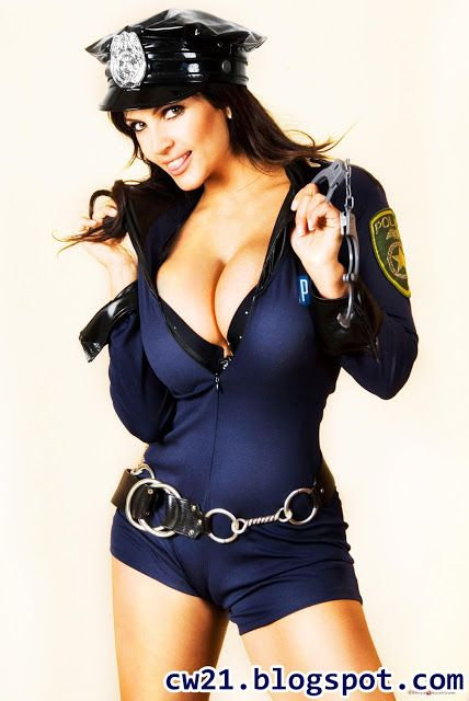 Share: Denise Milani Busty Cop 1