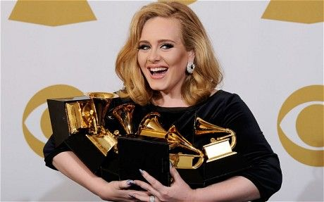 ADELE ~ 6 Grammy's included song, record, and album of the year. Click to watch her Grammy performance. http://www.craveonline.com/music/articles/182997-watch-adeles-rolling-in-the-deep-grammy-performance