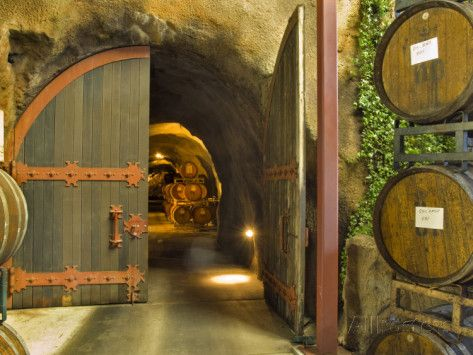 Oak Barrels Stacked Outside of Open Door To Aging Caves at Ironstone Winery, California, USA Photographic Print by Janis Miglavs at AllPosters.com