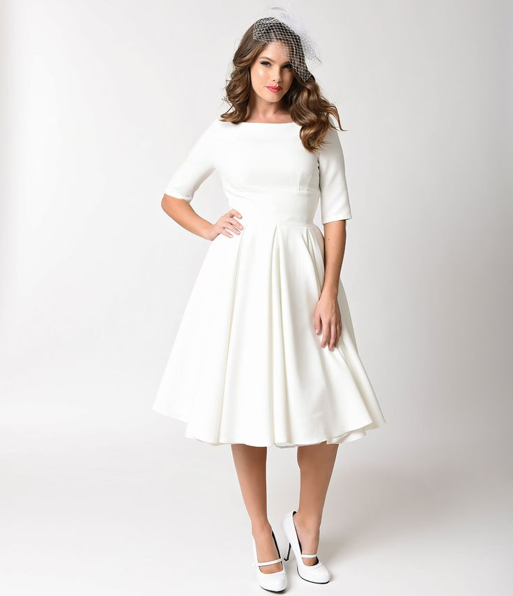 1950s Style Wedding Dresses Ivory Crepe Sleeved Hepburn Swing Dress $172.00 AT vintagedancer.com
